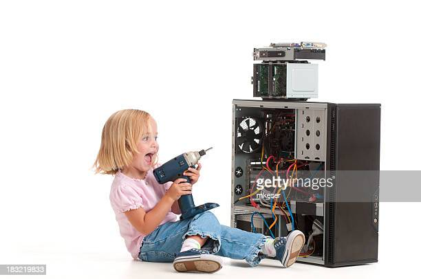 Girl 'fixing' her computer with a power drill.