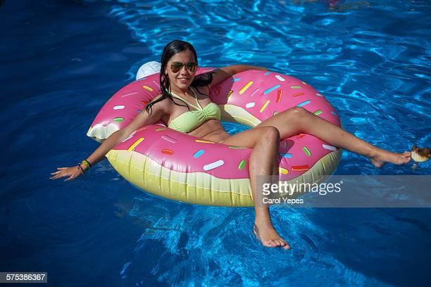 Girl floating in tube at pool