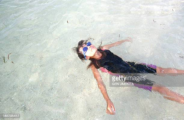 Girl floating on the sea