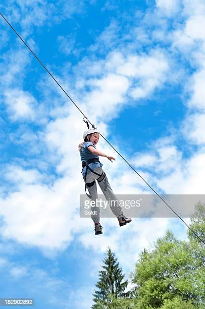 girl flying on a zipline | outdoor adventure