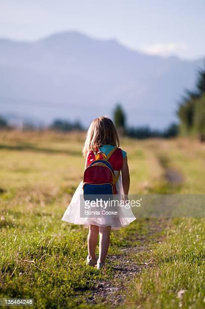 Girl following path in paddock