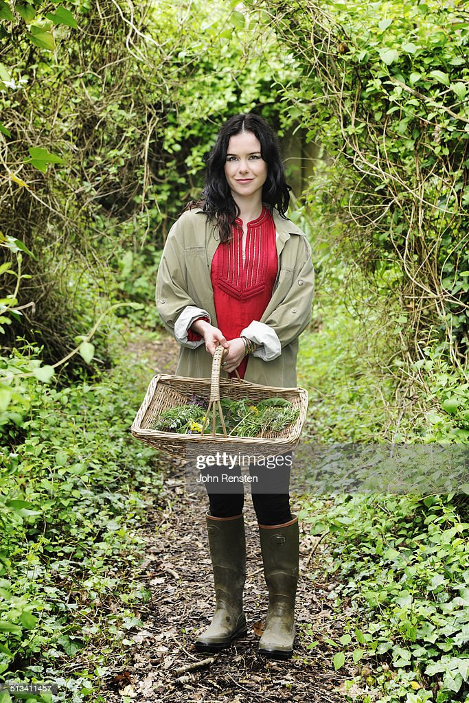 girl foraging for edible and medicinal herbs