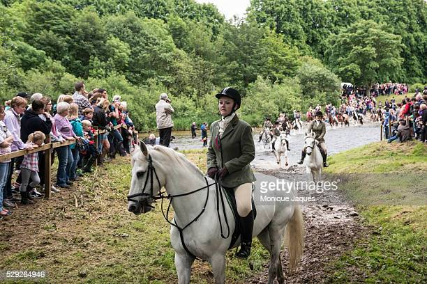 A girl fords the river at the Selkirk Common Riding event on June 13th 2014 The event a celebration of ancient traditions and history began when the...