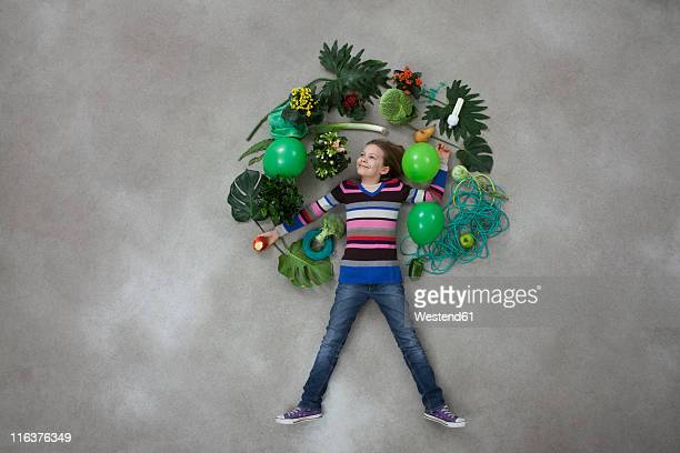 Girl forming tree shape on gray background