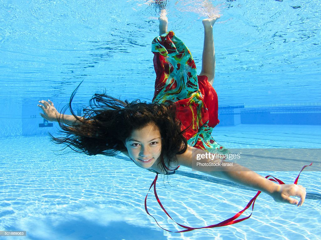 Girl Free Diving Under Water In Swimming Pool Stock Photo Getty Images