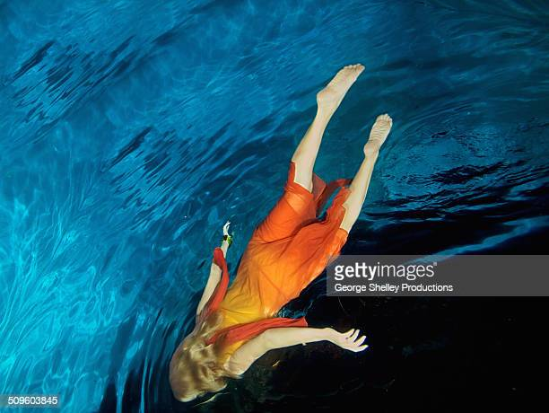Girl free falling in an underwater illusion