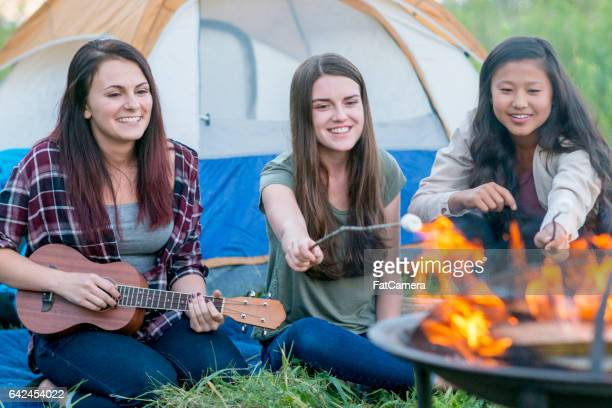 Girl Friends Hanging Out Around the Fire