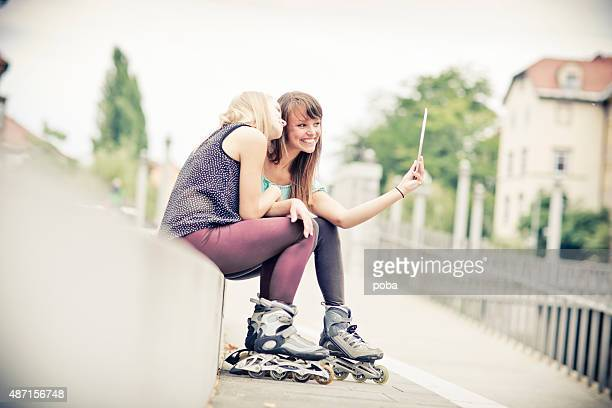 Girl Friends Hanging Out Together and  having fun with rollerskates