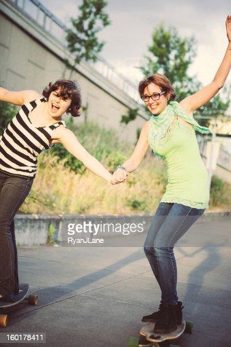 Girl Friends Having Fun Skateboarding : Stock Photo