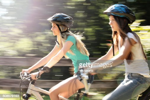 girl friends riding bikes : Stock Photo