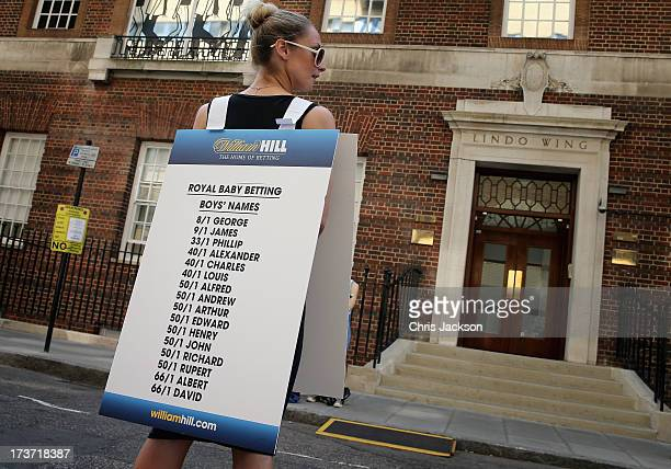 A girl from a Betting Company wears a board highlighting the latest odds on babies names outside the Lindo wing of St Mary's Hospital as the UK...