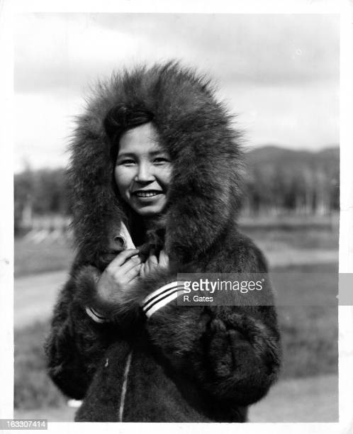 A girl from Eskimo decent wearing fur over her head in Alaska 1955