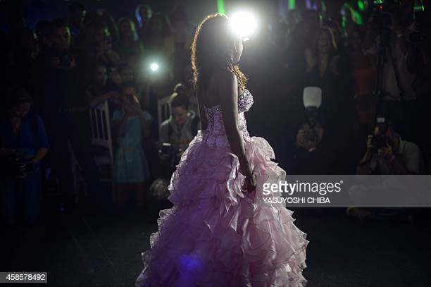A girl from the CerroCora favela who turns 15 this year poses as she heads to her group debutante ball organized by the Pacifying Police Unit from...