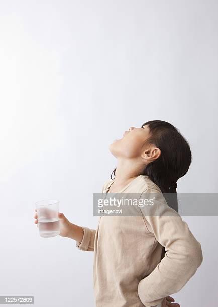 A girl gargleing her throat