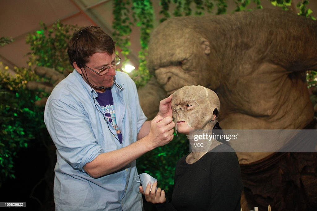 A girl gets make-up from Weta Workshop chief Sir Richard Taylor during the 3rd Beijing International Film Festival carnival at Olympic Center on April 16, 2013 in Beijing, China.