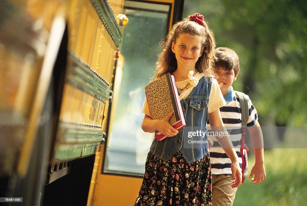 Girl getting off school bus