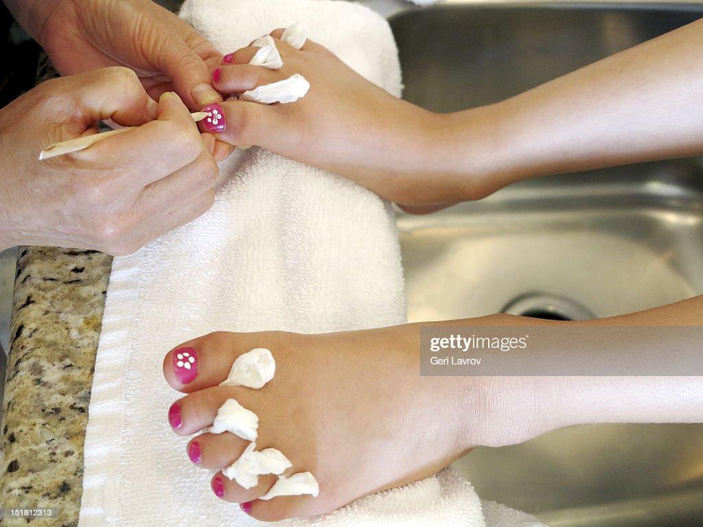 Girl getting pedicure : Stock Photo