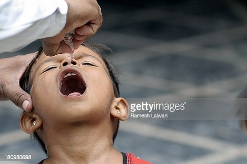 Girl getting polio drops