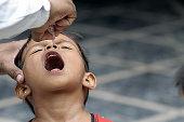 Girl getting polio drops