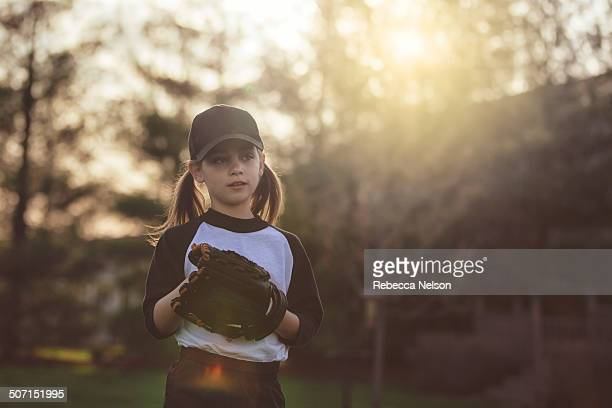 girl getting ready to throw baseball