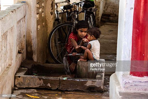 A girl gives water to her brother who is thirsty near Santoshi Mata temple Chitrakoot Dham Karwi Navratri is one of the holiest Hindu festivals where...