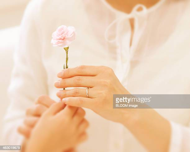Girl Giving Flower To Woman