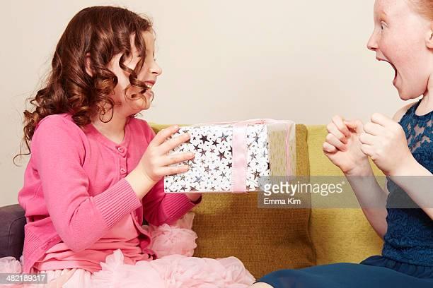 Girl giving friend birthday present