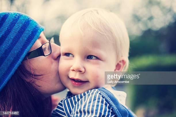 Girl giving little boy kiss on cheek