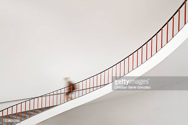 Girl goes down staircase