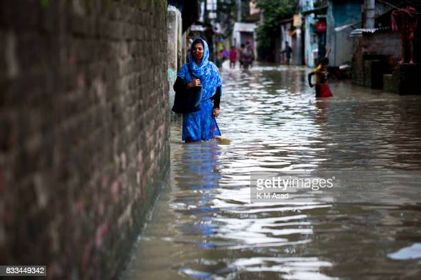 AGRABAD DHAKA CHITTAGONG BANGLADESH A girl going home in a flooded area of Chittagong Chittagong city is facing unprecedented flooding this year due...