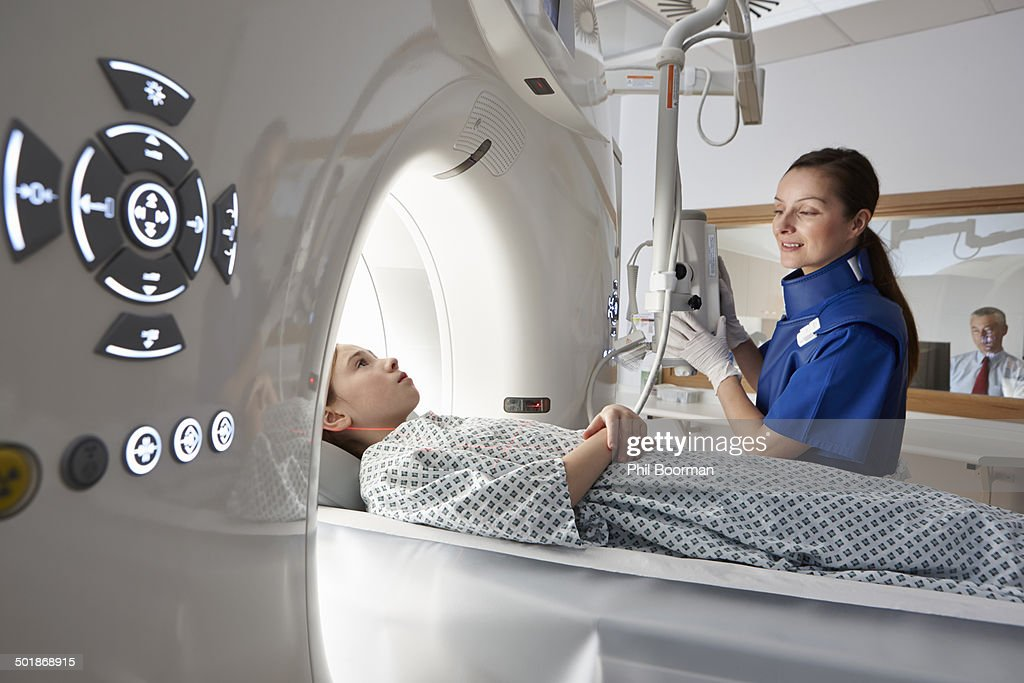 Girl going into CT scanner