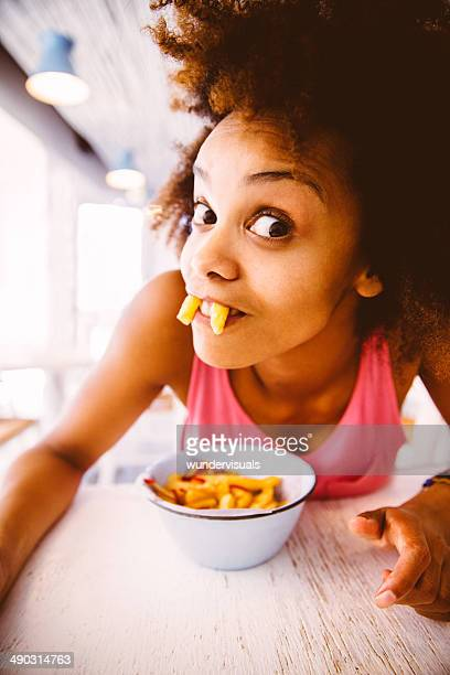 Girl goofing around with french fries