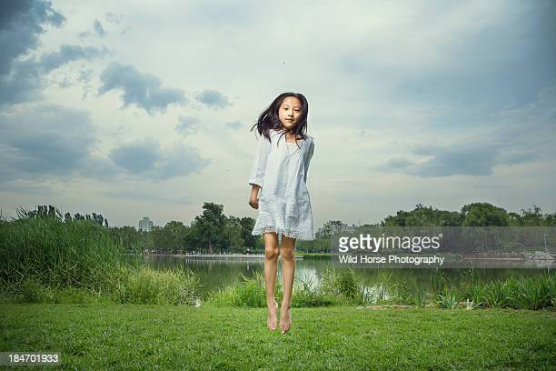Girl gracefully jumping in the air