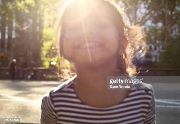 Girl grinning at the camera