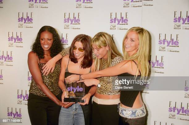 Girl group All Saints win the prize for 'Most Stylish Look' at the Elle Magazine Style Awards at the Home Club London 21st September 1999 From left...