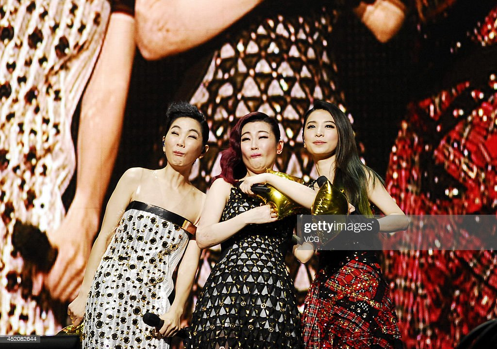 Girl group S.H.E. perform on stage during 'S.H.E 2Gether 4Ever Encore Concert' at Mercedes-Benz Arena in July 12, 2014 in Shanghai, China.