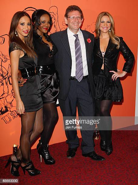 Girl group Sugababes Amelle Berrabah Keisha Buchanan and Heidi Range arrive with Lucian Grainge at the Music Industry Trusts' Awards held at the...