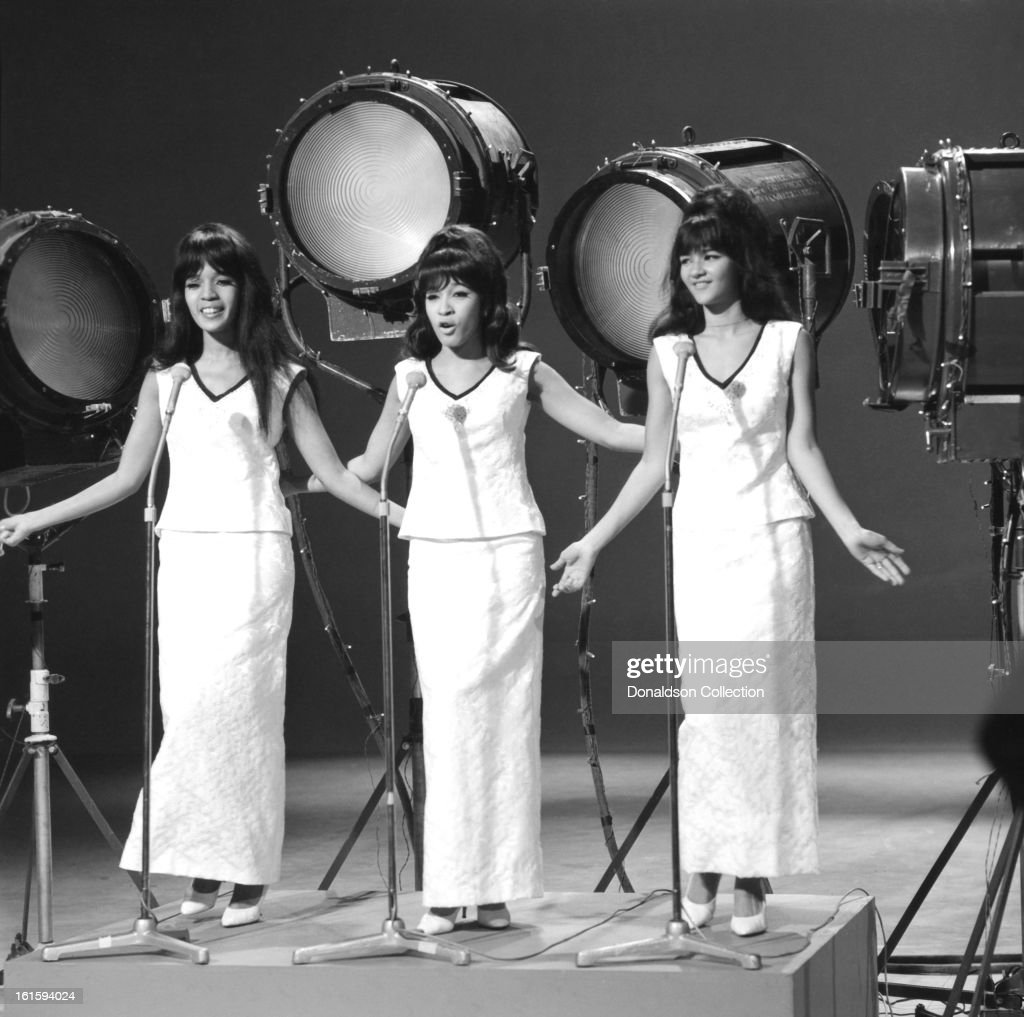 Girl group The Ronettes (L-R Estelle Bennett, Veronica Bennett and Nedra Talley) perform on the NBC TV music show 'Hullabaloo' in December 1965 in New York City, New York.