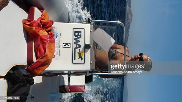 CONTENT] A girl handling a yacht in the Mediterranean Sea near the famous Stintino beach in Sardinia
