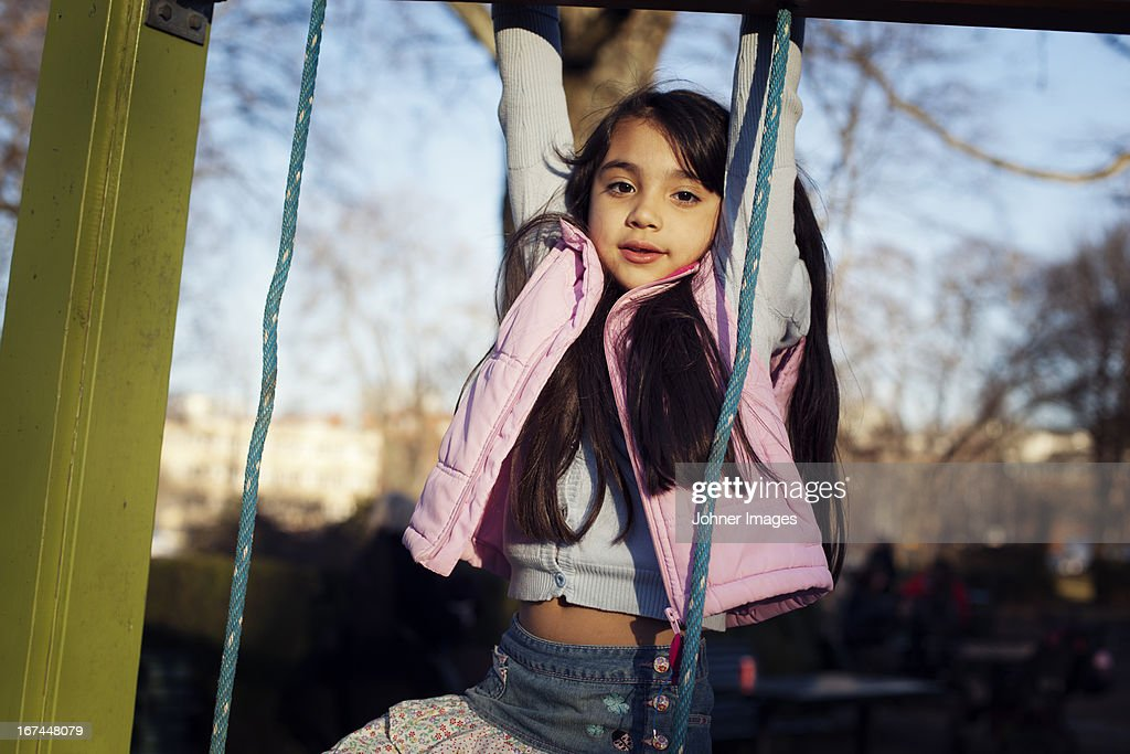 Girl hanging and looking at camera : Stock Photo