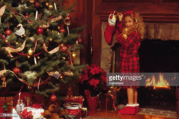 Girl hanging Christmas stocking