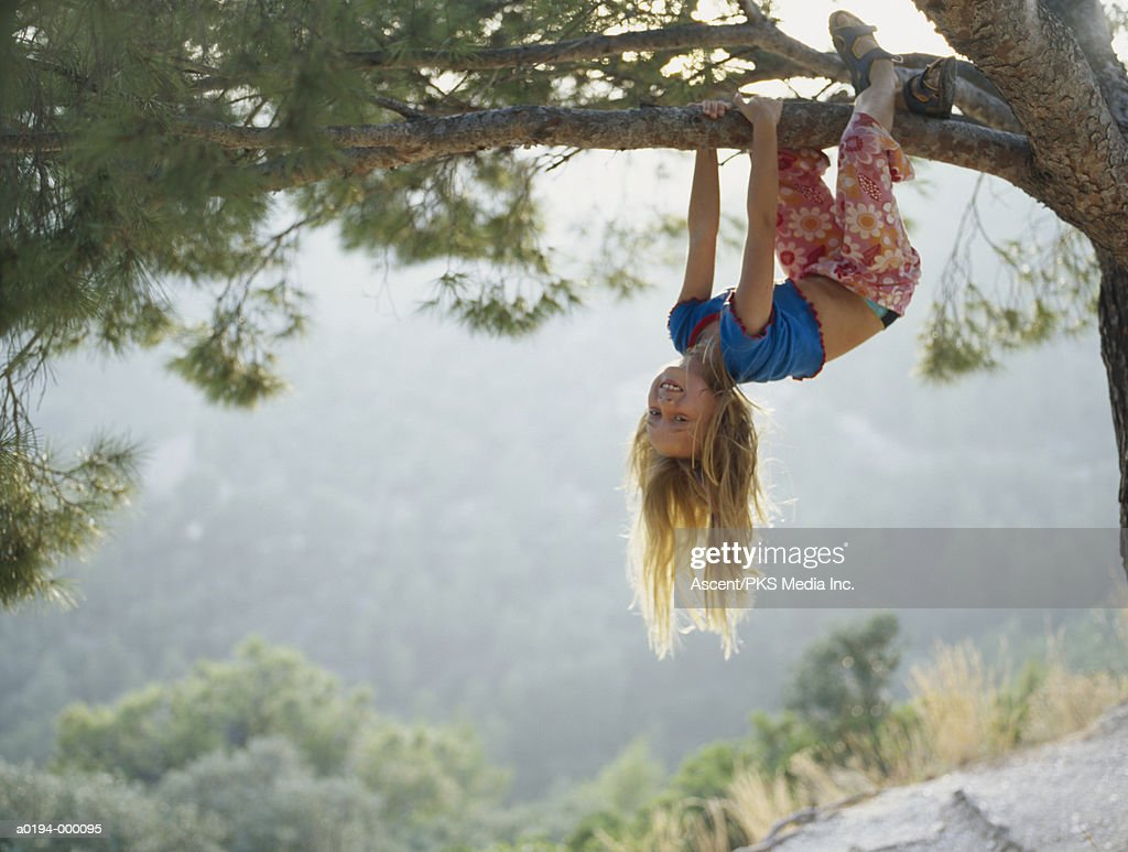 Girl Hanging Upside Down : Stock Photo