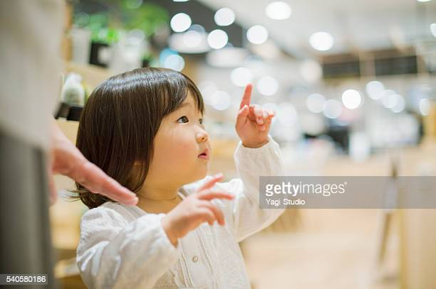 Girl has come to the shopping with mother