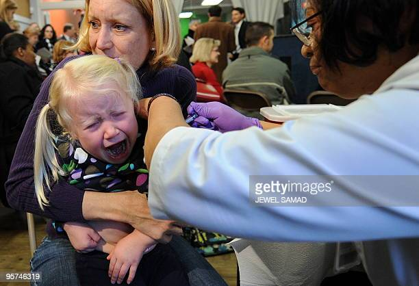 A girl has her H1N1 vaccination injected at a community clinic in Washington DC on January 13 2010 Swine flu has killed at least 12799 people...