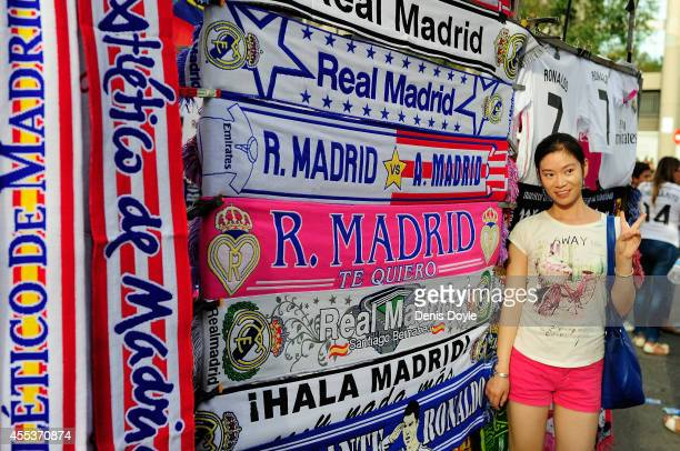A girl has her photo token outside the Santiago Bernabeu stadium prior to kickoff for the La Liga match between Real Madrid and Atletico de Madrid at...