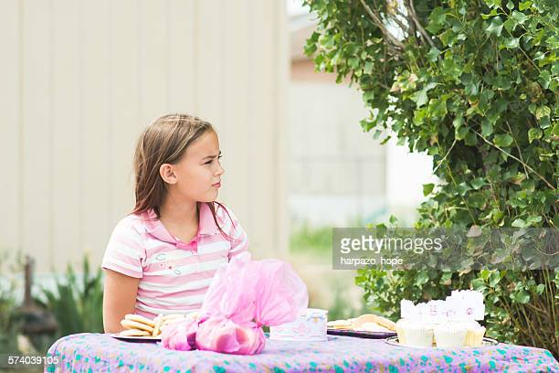 Girl having a bake sale