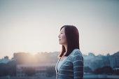 Girl having a refreshing breath in morning sunrise