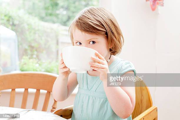 Girl (4-5) having cereals for breakfast