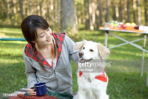 Girl having fun with dog : Stock Photo