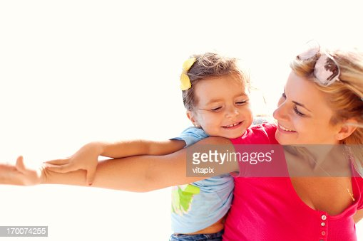 Girl having fun with her mother on a beach : Stock Photo